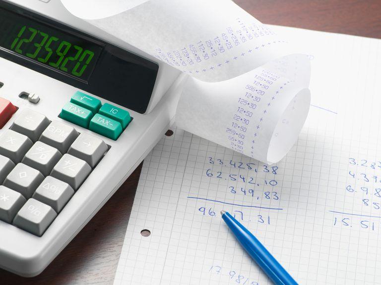 calculator and math written on ledger
