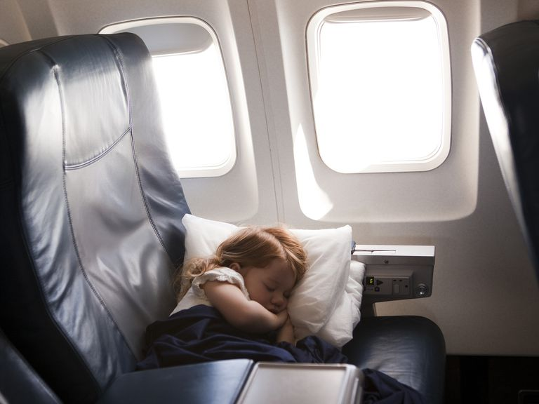 girl (2-3) sleeping in airplane seat