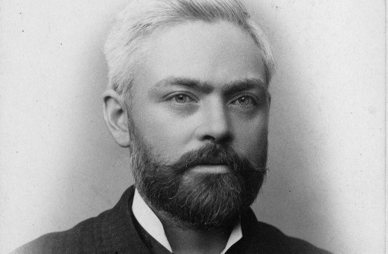 Black and white portrait of William Holabird, receding hair, full beard, intense eyes