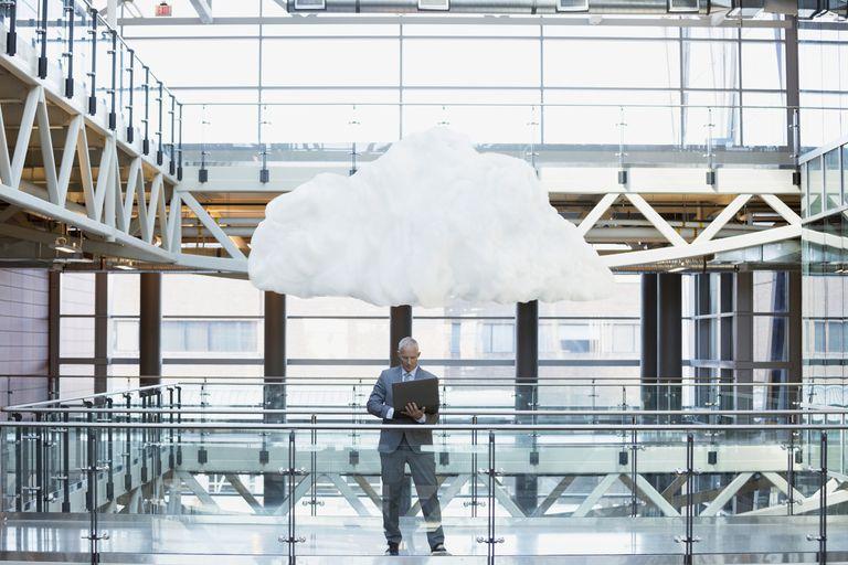 Cloud over businessman's head