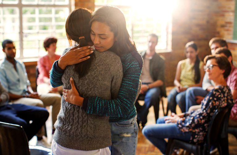 Grief-stricken women hugging