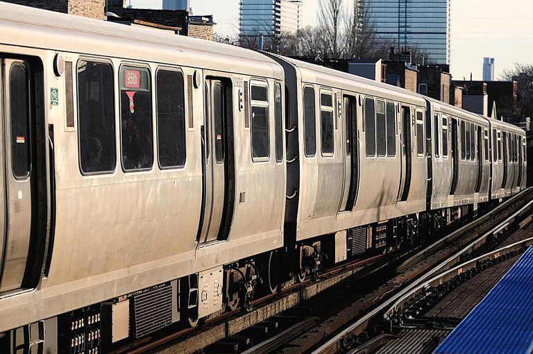 Elevated train descends into subway