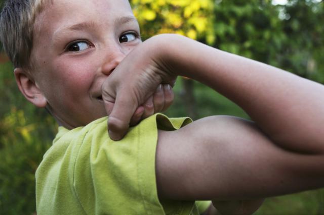 Boy flexing muscle