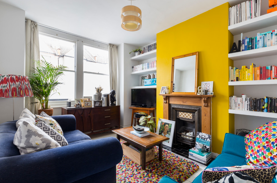 Bright Yellow Living Room Accent Wall