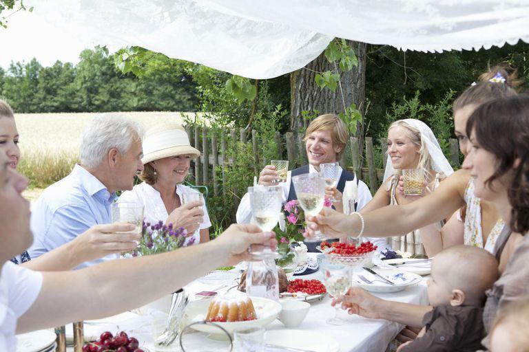 Wedding party toasting newlywed couple.