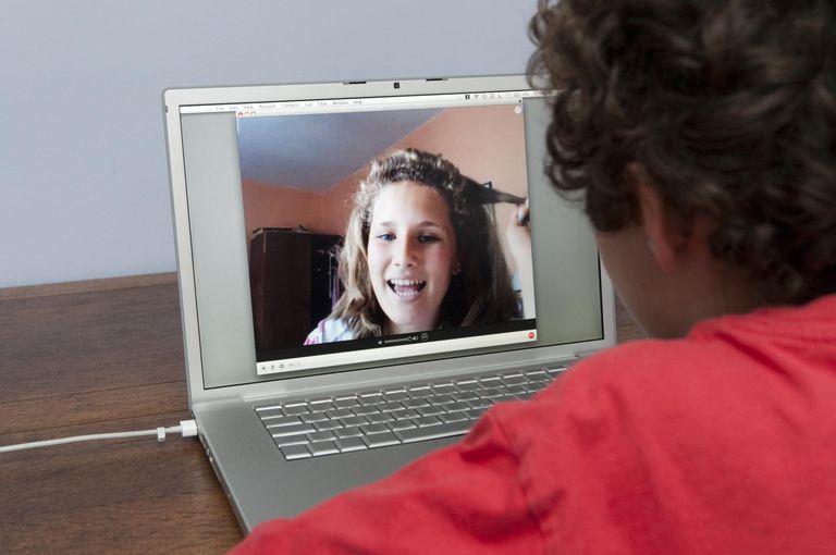 Teenagers talking via video call