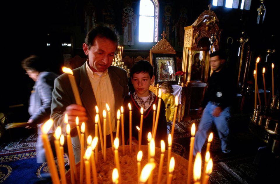 Greek Orthodox candle lighting