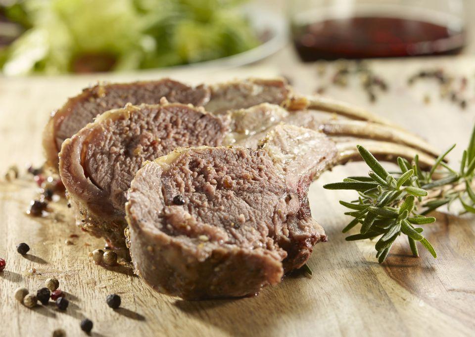 Cut lamb chops on board