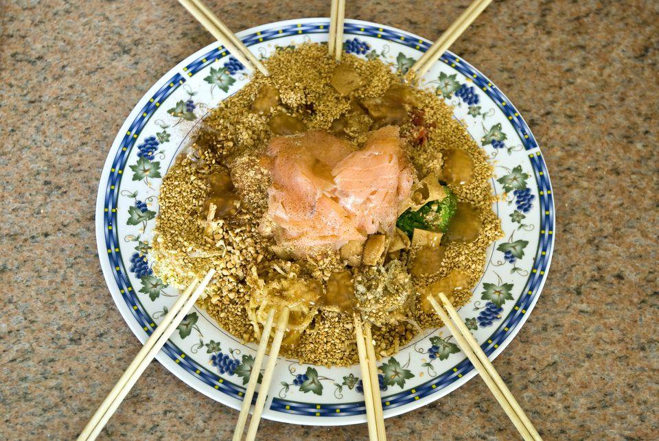 Tossing a bowl of Yu Sheng.