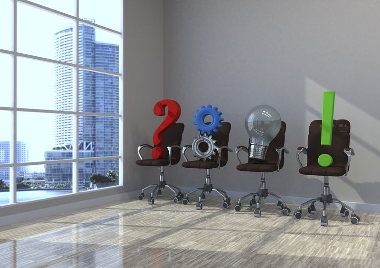 A question mark, gears, light bulb and exclamation point on swivel chairs.