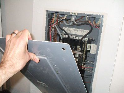 Gently Remove Outer Panel of Service Panel