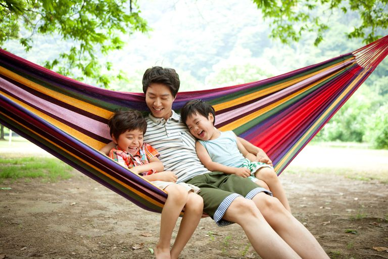 Father and two children in hammock