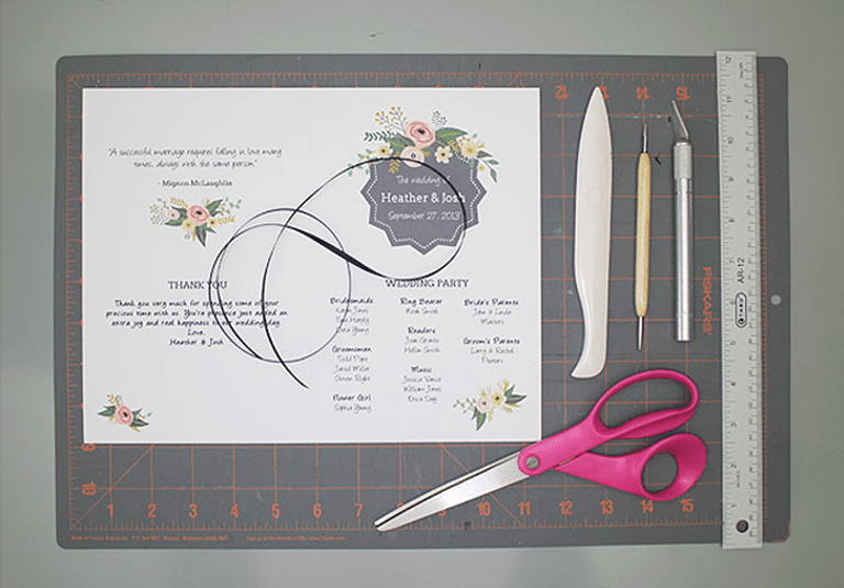Picture of a wedding program, scissors, and a ruler
