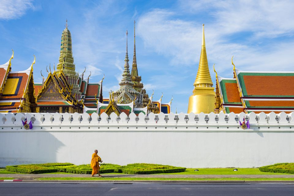 A monk passes in front of Wat Phra Kaew and the Grand Palace, Bangkok, Thailand, Southeast Asia, Asia