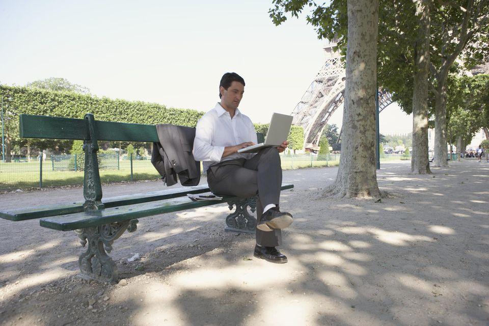 France, Paris, man sitting on bench