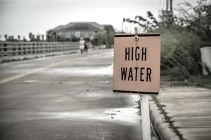 Disaster area with high water sign FEMA claim disaster area