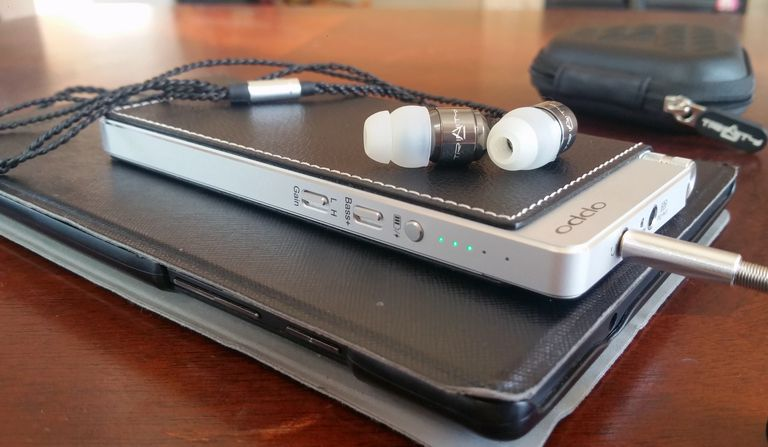 The OPPO Digital HA-2SE portable headphone DAC/Amp with a tablet and in-ear monitors