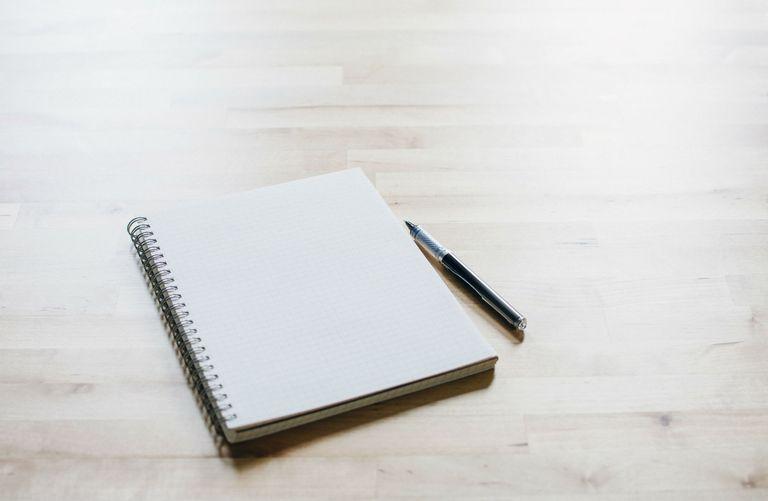 Studio shot of spiral notebook and ballpoint pen