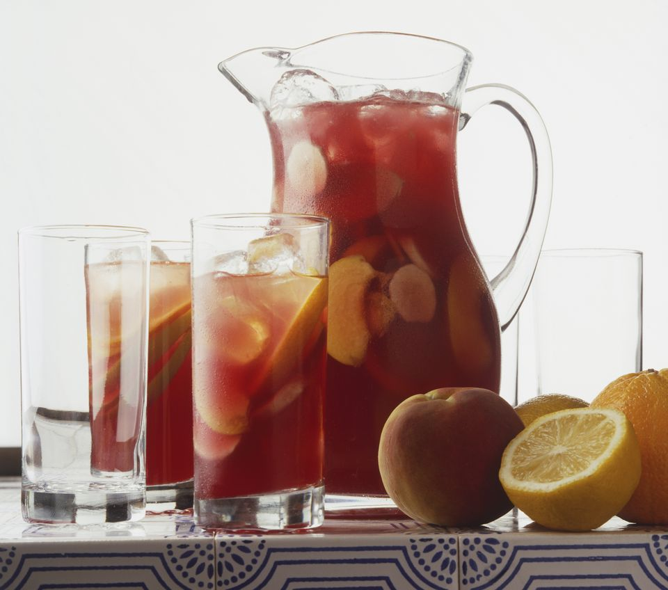 Sangria in jug and tumblers, and fresh fruit