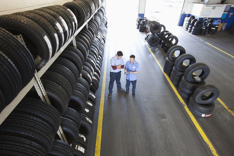 Two mechanics in tire center talking