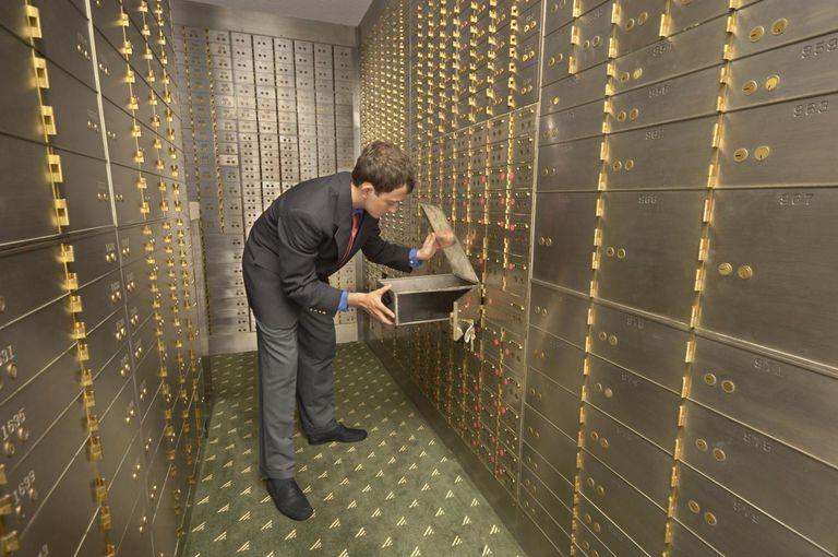 Man looking in safe deposit box in bank vault