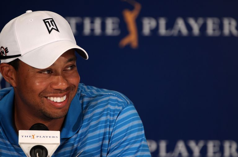 Tiger Woods smiles during a press conference appearance