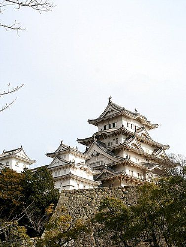 Bright winter sun glints of Himeji Castle, built 1333-1346 A.D. in Hyogo Prefecture, Japan.
