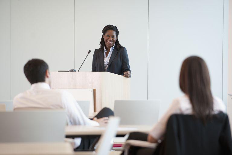 Black businesswoman speaking at podium
