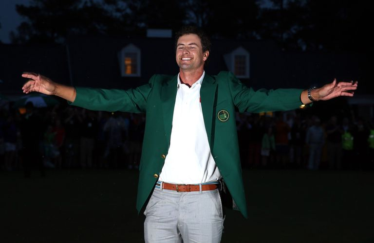 Adam Scott dons the Green Jacket as Masters champion in 2013.