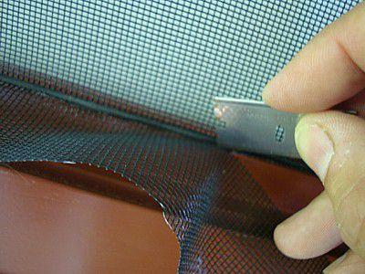 trim excess screen material at spline