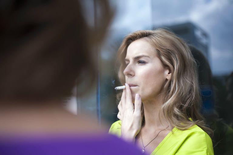 Woman smoking outside