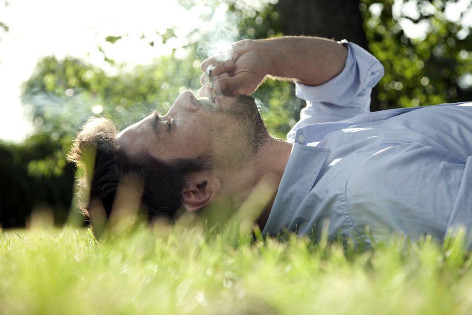 Photo of Man Smoking Marijuana Outdoors