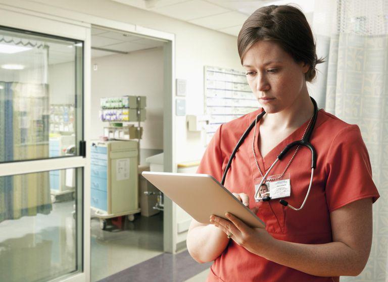 Caucasian nurse using tablet computer