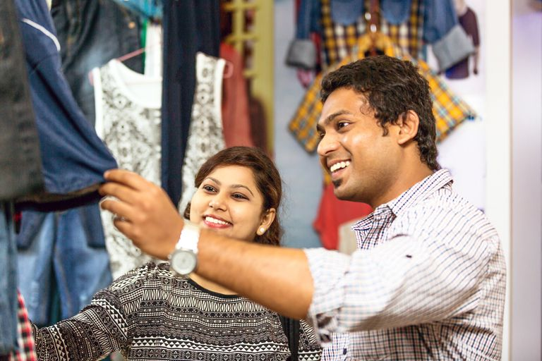 Happy Indian couple shopping together.