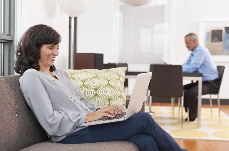 Mature woman on sofa using laptop