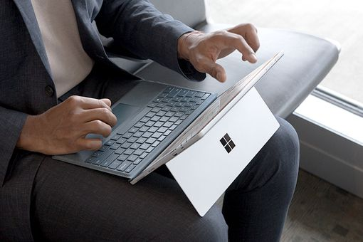 Man using Windows 10 on a Surface Pro laptop/tablet