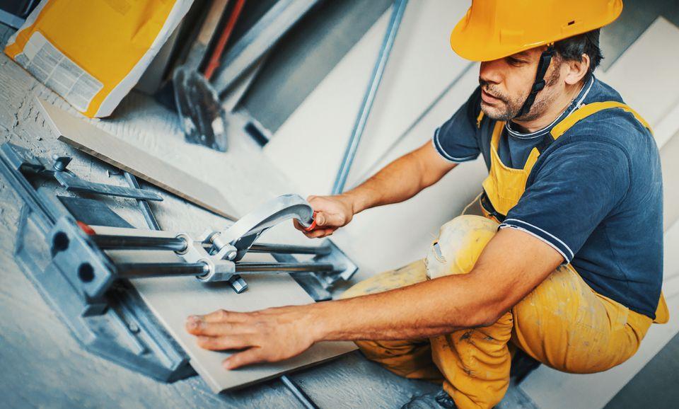 Handyman cutting tile