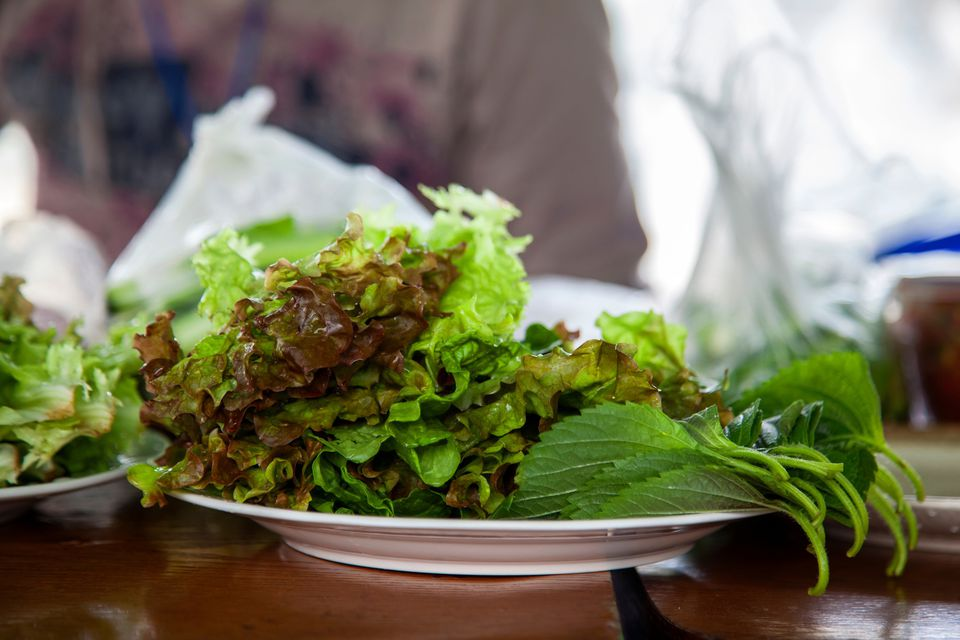 Close-Up Of Leaf Vegetables In Plate On Table