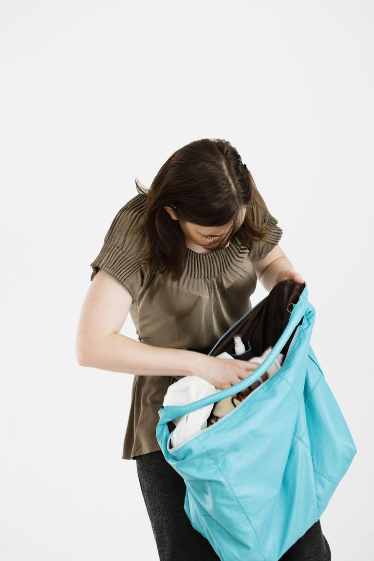 Short women should stay away from very large handbags because their size is out of proportion for petites.