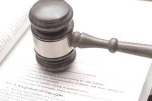 Judges gavel on book about copyright infringement
