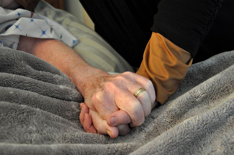 Person holding patient's hand