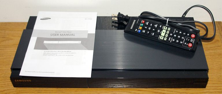 Samsung BD-J7500 Blu-ray Disc Player - Front View with Remote and Quick Start Guide