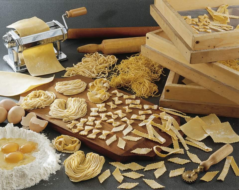 Assorted handmade pastas, tools and ingredients