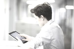 Teenage boy using digital tablet