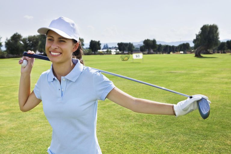 Portrait of a young female golf player