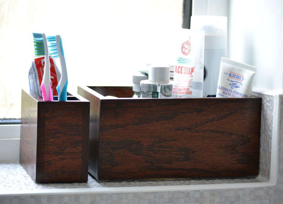 Use little boxes for bathroom storage