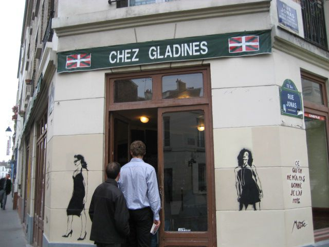 Chez Gladines' facade is decorated with images by celebrated Paris street artist Miss Tic.
