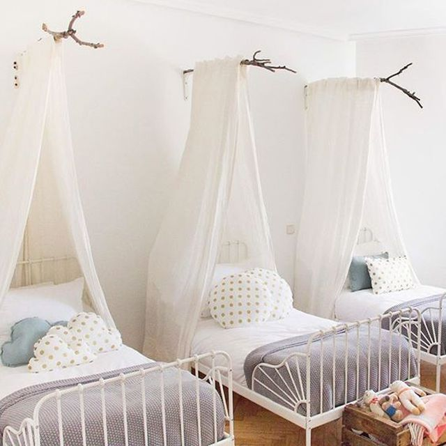 Triplet room with simple branch bed canopy