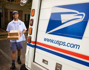 USPS Mail Carrier Delivering Packages