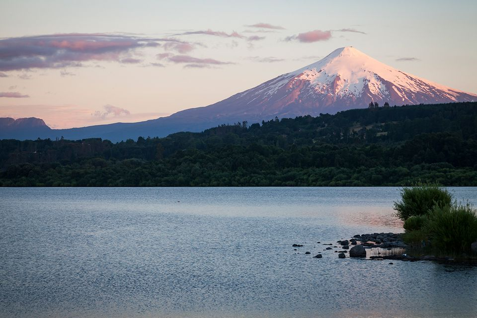 Villarica / Chile / Villarica Volcano and its eternal snow at sunset, with the lake at its feet.